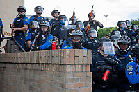 AUSTIN, TEXAS - MAY 30 Austin Police officers armed with pepper spray and less lethal rounds stand guard against protesters at APD Headquarters on May 30, 2020 in downtown Austin, Texas<br /> <br /> Use of this image in advertising or for promotional purposes is prohibited.<br /> <br /> Editorial Credit: Photo by Dan Herron / Herron Stock