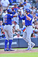 Chicago Cubs third baseman Kris Bryant (17) is greeted at home by Jason Heyward (22) after hitting a home run during a game against the Atlanta Braves at Turner Field on June 11, 2016 in Atlanta, Georgia. The Cubs defeated the Braves 8-2. (Tony Farlow/Four Seam Images)