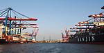 Hamburg-Germany - May 04, 2013 -- Port of Hamburg / harbour at the river Elbe: container cranes at CTB Container Terminal Burchardkai (left) and EUROGATE (right)(both HHLA, Hamburger Hafen und Logistik Aktiengesellschaft), with the Köhlbrandbrücke (bridge over Koehlbrand), Hanjin line, Infrastructure -- Photo: © HorstWagner.eu