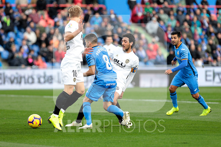 Getafe CF's Francisco Portillo and Valencia CF's Daniel Parejo during La Liga match between Getafe CF and Valencia CF at Coliseum Alfonso Perez in Getafe, Spain. November 10, 2018.