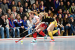 Mannheim, Germany, January 24: During the 1. Bundesliga Damen Hallensaison 2014/15 quarter-final hockey match between Mannheimer HC (white) and Harvestehuder THC (black) on January 24, 2015 at Irma-Roechling-Halle in Mannheim, Germany. Final score 2-3 (2-2). (Photo by Dirk Markgraf / www.265-images.com) *** Local caption *** Nike Lorenz #16 of Mannheimer HC, Annelotte Ziehm #23 of Harvestehuder THC