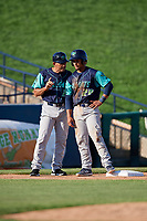 Lynchburg Hillcats manager Rouglas Odor (24) talks with catcher Angel Lopez Alvarez (20) after reaching third during the first game of a doubleheader against the Frederick Keys on June 12, 2018 at Nymeo Field at Harry Grove Stadium in Frederick, Maryland.  Frederick defeated Lynchburg 2-1.  (Mike Janes/Four Seam Images)