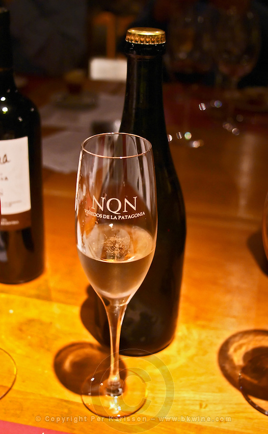 A glass flute of sparkling wine, engraved with the name of the winery. Bodega NQN Winery, Vinedos de la Patagonia, Neuquen, Patagonia, Argentina, South America
