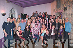 BON VOYAGE: Tommy McCarthy of Paddy Mac's bar, Tralee and Aideen O'Connor, the Greyhound bar, Tralee (both seated centre), had a fab farewell night in the Greyhound last Saturday as they are both heading for Australia shortly.