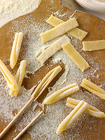 Traditional Italaian Casarecce pasta being made in a rustic setting