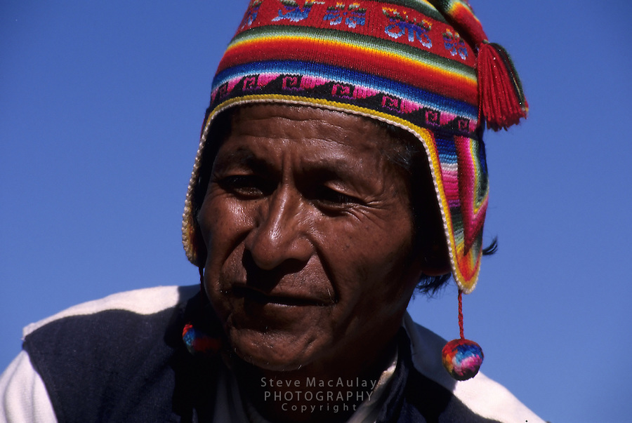 Old Peruvian man in traditional hat and tunic, Taquile Isalnd, Lake Titicaca, Peru