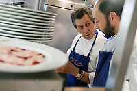 Chef Jacques Maximin supervises a member of his team in the kitchen of his restaurant Le Bistro de la Marine, Cagnes sur Mer, France, 07 April 2012