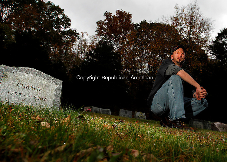 Kent, CT- 15, October 2010-101510CM02  Yvon Michaud takes a break at the Balmoral Pet Cemetery in Kent Friday afternoon.  Michuad is responsible for transporting and picking up animal ashes, for Balmoral, one of the pet cemeteries in the state.  Christopher Massa Republican-American