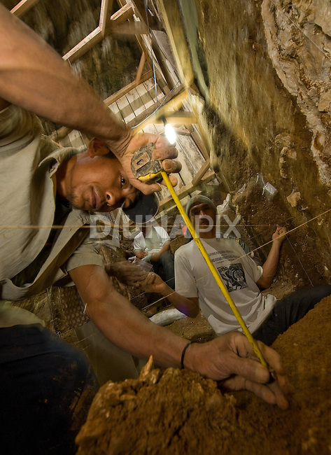 """The positions of artifacts unearthed at Liang Bua cave are carefully measured and recorded by experienced Manggarai workers. The type specimen of the Flores """"hobbit"""", Homo floresiensis, was discovered just meters from this site."""