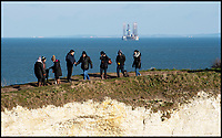 BNPS.co.uk (01202 558833)<br /> Pic: PhilYeomans/BNPS<br /> <br /> Sightseers at Old Harry Rocks on the Jurassic coast near Poole in Dorset.<br /> <br /> Hold your horses - Alarmed conservationists are calling on the government to stop an oil rig drilling operation off the south coast because of the affect it could have on a precious seahorse colony.<br /> <br /> The 100m high platform is currently drilling an appraisal well for oil deep under Poole Bay, Dorset, which forms part of Britain's UNESCO World Heritage Jurassic Coast.<br /> <br /> Shallow areas of the bay are a well known breeding ground for both the native breeds of seahorses which are a heavily protected species.<br /> <br /> But at this time of year the mystical creatures over-winter in deeper waters close to where the ENSCO 72 rig is positioned.<br /> <br /> Its arrival has sparked anger with not only environmentalists but also many residents of Bournemouth who can clearly see the 250ft wide platform from its famous seafront.