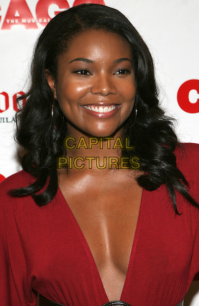 "GABRIELLE UNION.Usher's premiere on the Broadway show ""Chicago"" - Arrivals, New York, NY, USA..August 22nd, 2006.Ref: ADM/JL.headshot portrait red plunging neckline cleavage.www.capitalpictures.com.sales@capitalpictures.com.©Jackson Lee/AdMedia/Capital Pictures."