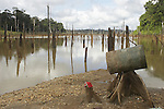 Landing beach at an unregulated gold mining operation on the Brokopondo reservoir, Suriname.  The man-made lake was hastily created by flooding a vast acreage of jungle without any prior logging and evacuation of animals and is reputed to be polluted by mercury from the mines..