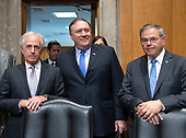 """United States Secretary of State Mike Pompeo, center, poses for a photo with US Senator Bob Corker (Republican of Tennessee), left, Chairman, US Committee on Foreign Relations, and US Senator Bob Menendez (Democrat of New Jersey), Ranking Member, right, prior to giving testimony before the committee on """"An update on American Diplomacy to Advance our National Security Strategy"""" on Capitol Hill in Washington, DC on Wednesday, July 25, 2018.  Pompeo took questions on the Helsinki Summit with President Putin of Russia and progress on the denuclearization of North Korea.<br /> Credit: Ron Sachs / CNP"""