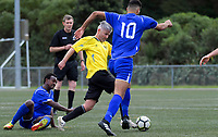 Action from the 2018 Men's Capital Division Three football match between Petone (blue) and Island Bay (gold) at Wakefield Park in Wellington, New Zealand on Saturday, 26 May 2018. Photo: Dave Lintott / lintottphoto.co.nz