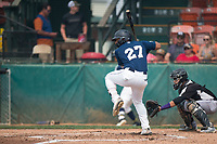 Helena Brewers outfielder Leugim Castillo (27) at bat in front of catcher Javier Guevara (6) during a Pioneer League game against the Grand Junction Rockies at Kindrick Legion Field on August 19, 2018 in Helena, Montana. The Grand Junction Rockies defeated the Helena Brewers by a score of 6-1. (Zachary Lucy/Four Seam Images)