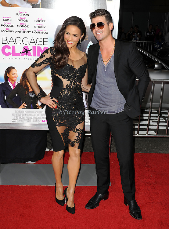 """Paula Patton and Robin Thicke at the Los Angeles Premiere of """"Baggage Claim Premiere"""" held at Regal Cinemas L. A. LIVE on September 25, 2013"""