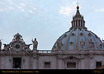 Michelangelo Dome 1590 and Giuseppe Valadier Clock 1790 at Dusk St Peter's Basilica Rome