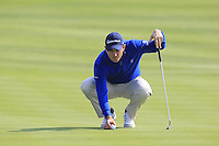 Justin Rose (ENG) lines up his ball on the 8th green during Sunday's Final Round of the 2014 BMW Masters held at Lake Malaren, Shanghai, China. 2nd November 2014.<br /> Picture: Eoin Clarke www.golffile.ie