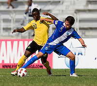 Jason Wright (10) of Jamaica fights for the ball with Julio Ortiz (5) of Guatemala during the group stage of the CONCACAF Men's Under 17 Championship at Catherine Hall Stadium in Montego Bay, Jamaica. Jamaica defeated Guatemala, 1-0.