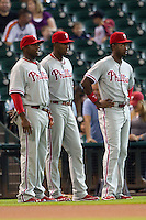 Philadelphia Phillies players (L to R) Ryan Howard, John Mayberry, and Dominic Brown before the Major League baseball game against the Houston Astros on September 16th, 2012 at Minute Maid Park in Houston, Texas. The Astros defeated the Phillies 7-6. (Andrew Woolley/Four Seam Images).