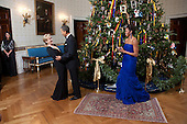 United States President Barack Obama and First Lady Michelle Obama greet Kennedy Center Honoree Meryl Streep in the Blue Room of the White House, December 4, 2011. .Mandatory Credit: Lawrence Jackson - White House via CNP