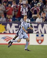Colorado Rapids forward Conor Casey (9) traps the ball as New England Revolution defender Darrius Barnes (25) defends. The Colorado Rapids defeated the New England Revolution, 2-1, at Gillette Stadium on April 24, 2010.