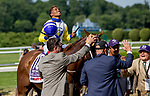ELMONT, NY - JUNE 09: Jockey Ricardo Santana Jr. celebrates after winning the Runhappy Metropolitan Handicapon Belmont Stakes Day at Belmont Park on June 9, 2018 in Elmont, New York. (Photo by Sue Kawczynski/Eclipse Sportswire/Getty Images)