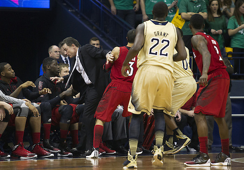February 09, 2013:  Louisville head coach Rick Pitino gets too close to the action during NCAA Basketball game action between the Notre Dame Fighting Irish and the Louisville Cardinals at Purcell Pavilion at the Joyce Center in South Bend, Indiana.  Notre Dame defeated Louisville 104-101 in five overtimes.