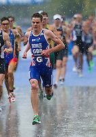 07 AUG 2011 - LONDON, GBR - Jonathan Brownlee (GBR) races through the rain at the start of the second run lap during the men's round of triathlon's ITU World Championship Series .(PHOTO (C) NIGEL FARROW)