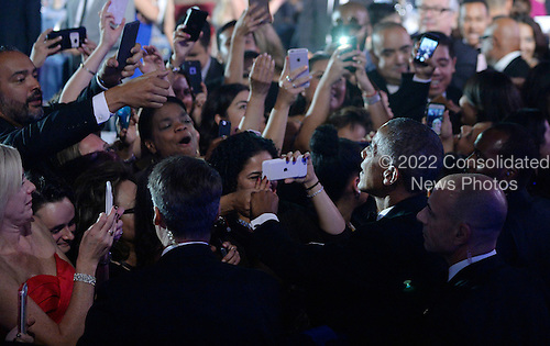 United States President Barack Obama checks hands with guests during the 39th Annual Congressional Hispanic Caucus Institute Public Policy Conference and Annual Awards Gala at the Walter E. Washington Convention Center September 15 2016, in Washington, DC. <br /> Credit: Olivier Douliery / Pool via CNP