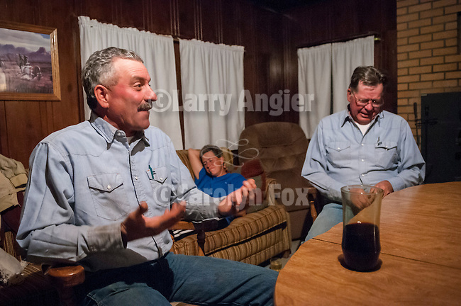Night time in the cabin during the fall cattle gathering in the High Sierra...Frank Busi & Elliot Joses with Cheryl Joses on the couch