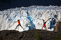 Adventurous couple enjouing the outdoors, Cascade Glacier and Barry Glacier,  Harriman Fiord, Prince William Sound, Chugach National Forest, Alaska.