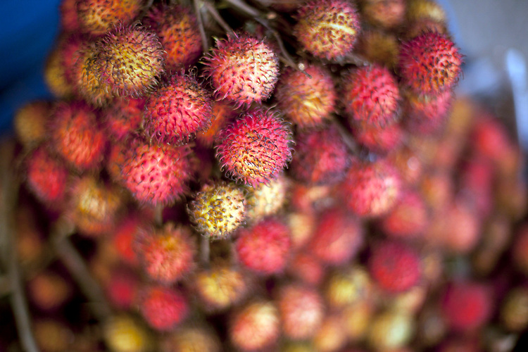 Lychee fruit for sale in a marketplace in Phnom Penh, Cambodia. <br /> <br /> Photos &copy; Dennis Drenner 2013.