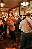 ENGLAND, London, an elderly couple dances to live music at a bar in London