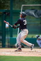 GCL Yankees West left fielder Stanley Rosario (38) hits a home run during the second game of a doubleheader against the GCL Braves on July 30, 2018 at Champion Stadium in Kissimmee, Florida.  GCL Braves defeated GCL Yankees West 5-4.  (Mike Janes/Four Seam Images)