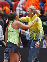 April 18, 2015, Netherlands, Den Bosch, Maaspoort, Fedcup Netherlands-Australia,   Casey Dellacqua (AUS) is being embrased by captain Alicia Molik<br /> Photo: Tennisimages/Henk Koster
