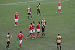 Players arguing with the referee at the Alexandra Stadium on Gresty Road, Crewe, the home of Crewe Alexandra (in red) during their home game against Leyton Orient in the SkyBet League One. The match was won by the visitors from London by 2-1 with two goals on debut by Chris Dagnall, sending Orient to the top of the league. The match was watched by 4830 spectators.