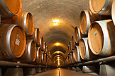 USA, California, Sonoma, Gundlach Bundschu Winery, wine barrels stacked in a cellar