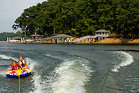Boating, tubing, fishing and relaxation are popular past times on North Carolina's Mountain Island Lake, one of three man-made lakes in and around Mecklenburg County, NC. (The other two lakes are Lake Norman on the north side of the county and Lake Wylie on the far south). The lake was created in 1924 during the building of the Mountain Island Hydroelectric Station. Mountain Island Lake has 61 miles of shoreline.