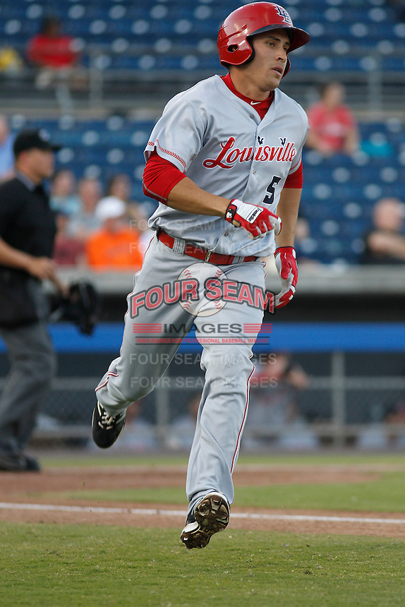 Louisville Bats infielder Seth Mejias-Brean (5) at bat during a game against the Norfolk Tides at Harbor Park on April 26, 2016 in Norfolk, Virginia. Louisville defeated defeated Norfolk 7-2. (Robert Gurganus/Four Seam Images)