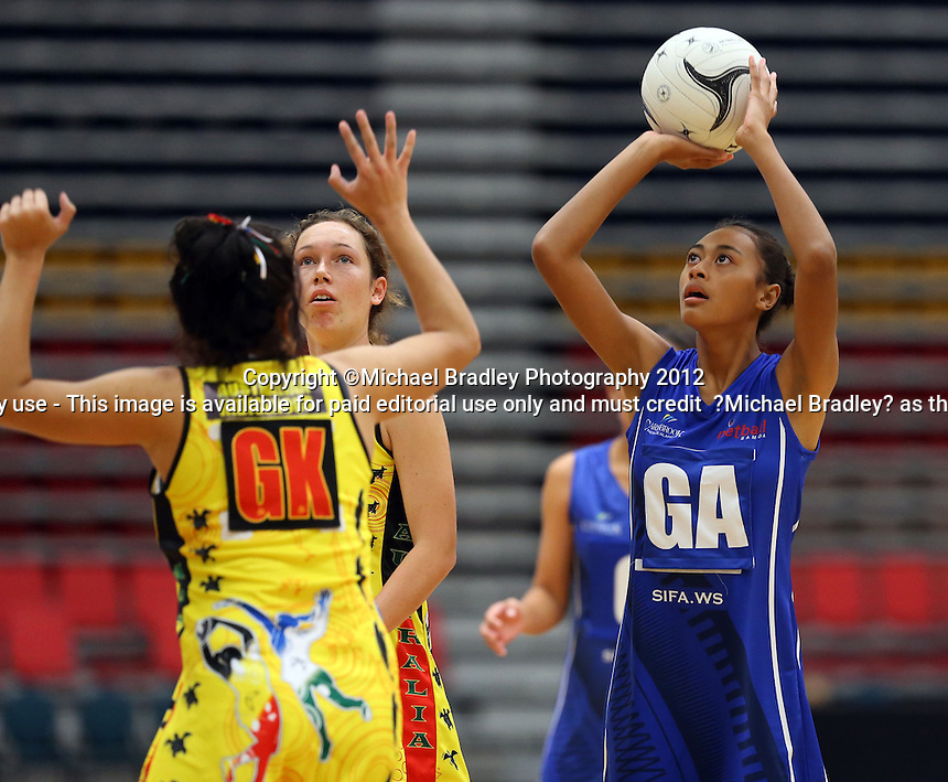 30.05.2013 Action during the netball match between ISSA and Samoa at the Transtasman Secondary Schools netball Tournament played at the Rotorua Events Centre in Rotorua. Mandatory Photo Credit ©Michael Bradley.
