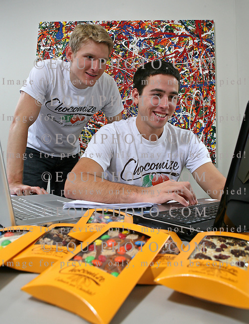 Fabian Kaempfer (L) Co-Founder and Ryan Sudeck, (R) Head of Marketing, check on  orders on the computer of their custom chocolate products at Chocomize.com in Cherry Hill, New Jersey.