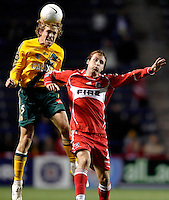 LA Galaxy defender Chris Albright (5) heads the ball over Chicago Fire midfielder Justin Mapp (21).  The Chicago Fire defeated the LA Galaxy 3-1 in the championship of the U.S. Open Cup at Toyota Park in Bridgeview, IL on September 27, 2006.