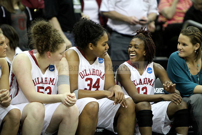 Players on Oklahoma's bench smile about their victory over UK Hoops in the NCAA Women's Basketball Kansas City Regional Finals Tuesday, March 30, 2010, at the Sprint Center. Photo by Brandon Goodwin | Staff