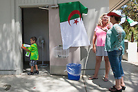 San Jose, CA - Monday, June 30, 2014: A group of around 30 Algerians  take a break during half time of the Algeria vs. Germany round of 16 match at the Arab Cultural Center.