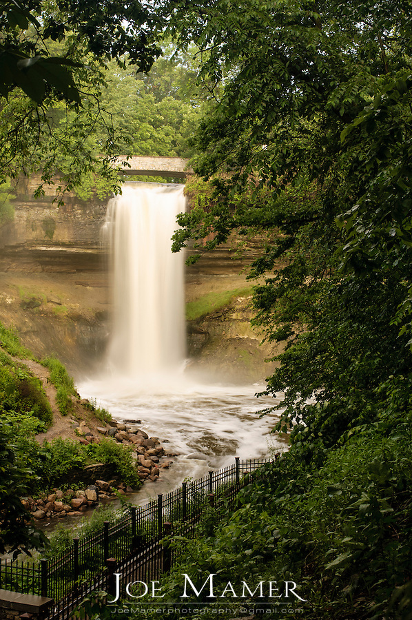 "53 foot tall Minnehaha falls on Minnehaha Creek. The translation of the name is ""curling water"" or ""waterfall"". The name comes from the Dakota language elements mni, meaning water, and haha, meaning waterfall.."
