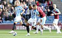 Huddersfield Town's Rajiv van La Parra holds off the challenge from Burnley's Johann Gudmundsson<br /> <br /> Photographer Rich Linley/CameraSport<br /> <br /> The Premier League - Burnley v Huddersfield Town - Saturday 6th October 2018 - Turf Moor - Burnley<br /> <br /> World Copyright &copy; 2018 CameraSport. All rights reserved. 43 Linden Ave. Countesthorpe. Leicester. England. LE8 5PG - Tel: +44 (0) 116 277 4147 - admin@camerasport.com - www.camerasport.com