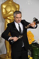 Alfonso Cuaron at the 86th Annual Academy Awards at the Dolby Theatre, Hollywood.<br /> March 2, 2014  Los Angeles, CA<br /> Picture: Paul Smith / Featureflash