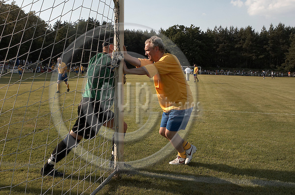 """BERLIN - GERMANY 14. JUNE 2006 -- Football match in Hohen Neuendorf - A friendship match between the swedish national team from 1974 and Berlins Hertha BSC traditions team. Result: 1-5 - Goeran Hagberk, Goal keeper and  Benno Magnusson (both SWE) -- PHOTO: CHRISTIAN T. JOERGENSEN /  EUP & IMAGES..This image is delivered according to terms set out in """"Terms - Prices & Terms"""". (Please see www.eup-images.com for more details)"""