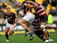 Wellington's Charlie Ngatai looks for support in the tackle. ITM Cup - Wellington Lions v Counties-Manukau Steelers at Westpac Stadium, Wellington, New Zealand on Sunday, 8 August 2010. Photo: Dave Lintott/lintottphoto.co.nz.
